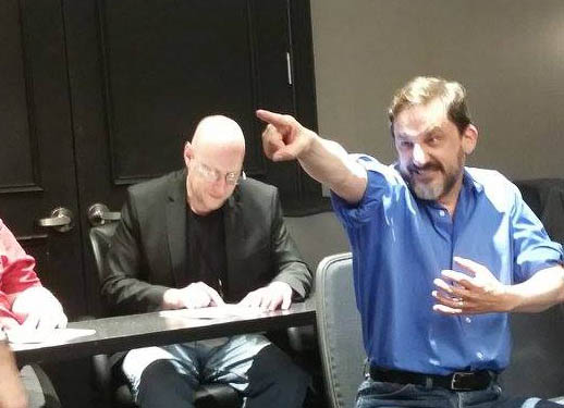 """Hamming it up in the """"Eye of Argon"""" reading at Balticon 2016 with Ian ignoring me in the background. (He was the editor judge!)"""